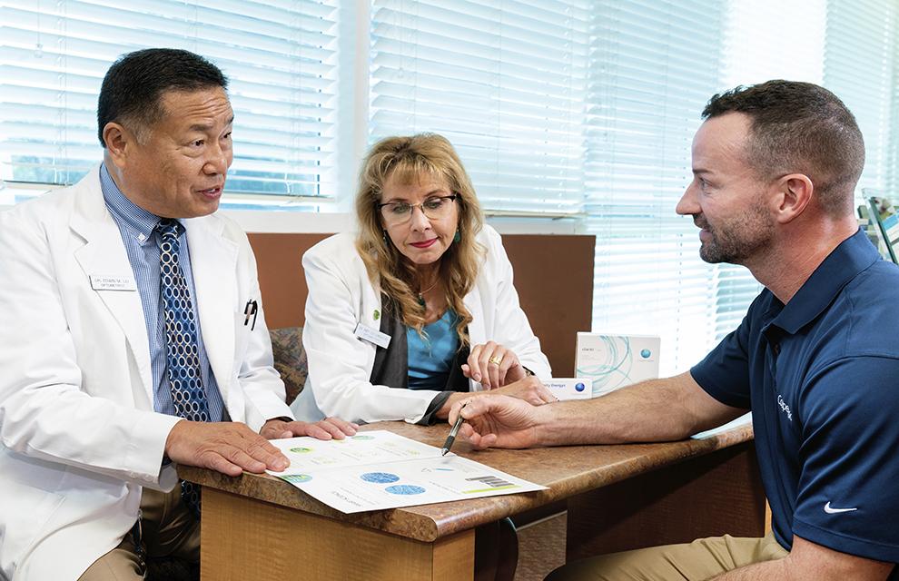 Doctors sitting around a desk