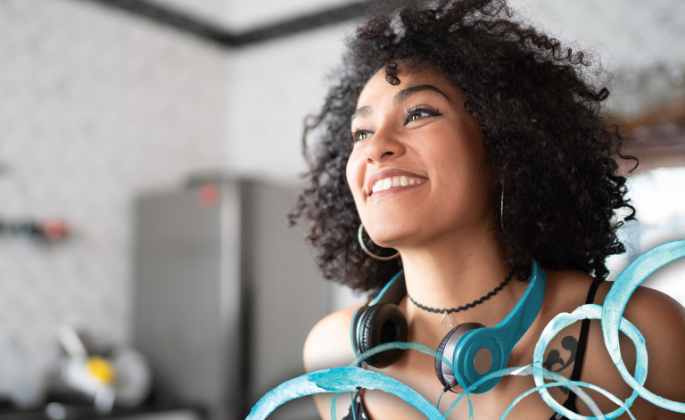 woman smiling with headphones on her head