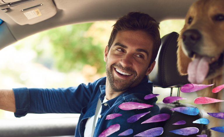 Man in car turning back and smiling